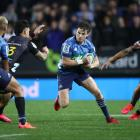 Beauden Barrett runs the ball up for the Blues against the Chiefs. Photo: Getty