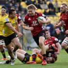 Jack Goodhue on his way to the try line in the Crusaders' win over the Hurricanes in Wellington...