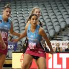 Steel defender Taneisha Fifita jostles for position with Magic shooter Kelsey McPhee during an...