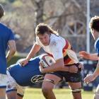 John McGlashan College's Harrison Morton runs the ball up against Southland Boys' High School at...