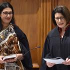 Judge Melinda Broek (left) is sworn in by Judge Jacquelyn Moran during a special sitting of the...
