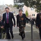 John McGlashan College personal assistant Jan Owen (centre) walks through a guard of honour with...