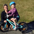 Grayson Wharerimu (4), supervised by his mum Jody, rides his new bike at Marlow Park in St Kilda...