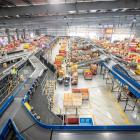 NZ Post's East Tamaki distribution centre. CourierPost is working through a huge backlog of...