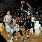 Otago Nuggets' forward BJ Anthony controls the ball as Waikato Pistons defenders Nick Barrow ...