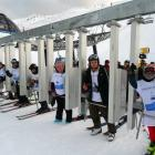 On the first chair at Coronet Peak yesterday are (from left) Roland Cameron, of Invercargill,...