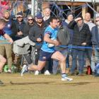 Wakatipu's Sam Collins makes a run for it at Jack Reid Park on Saturday, during his team's game...