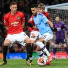 Riyad Mahrez controls the ball as Manchester City plays Manchester United in one of the English...