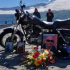 Tributes to Russell Allan Blackford laid alongside his now missing bike. Photo / NZ Police