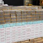 A businessman and his company smuggled millions of smokes into New Zealand inside steel cabinets....