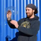 Creative Critters Design owner Keir Russell, of Mornington, inspects a laser-cut face shield he...