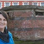 Dunedin City Council digital archivist Alison Breese outside the former public toilet near the...