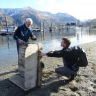 Wanaka Primary School teacher Markus Hermanns (right) learns about the Lake Wanaka marina...