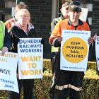Protesters outside the Dunedin Railway Station. Photo: Craig Baxter