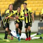 Andrija Kaludjerovic, Goran Paracki and Matthew Ridenton of the Wellington Phoenix celebrate an...