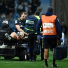 Highlanders lock Josh Dickson is taken off the field during a Super Rugby Aotearoa match against...