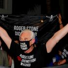 Roger Stone reacts outside his home in Fort Lauderdale, Florida, after US President Donald Trump...