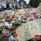 The crowds that had gathered in Hagley Park, Christchurch after the shooting. Photo: Alan Gibson ...