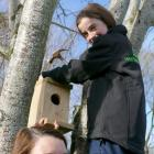 Zita Young helps her daughter Amy  put up the bird box she made during a recent West Otago Rural...