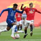 Callum Hudson-Odoi of Chelsea battles for possession with Brandon Williams of Manchester United...