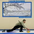 Kenny Thomson glides past a photograph of the 2001 Bonspiel  at Idaburn during the national...