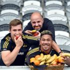 Looking to tuck into some fruit at Forsyth Barr Stadium yesterday are (from left) Highlanders...