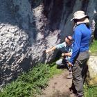 Otago Museum's Maori curator Gerard O'Regan points to rock art in a cliff in the central North...