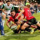 Julian Savea breaks the tackles of Ryan Crotty and Jack Goodhue to score a try in the 2018 Super...