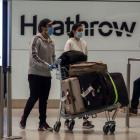Passengers in the arrivals lounge in Terminal 2 at Heathrow Airport in London. Photo: Getty