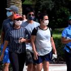 People wearing face masks walk at Lake Eola Park in Orlando, Florida. Photo: Getty Images