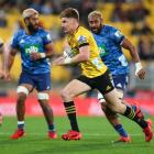 Jordie Barrett runs makes a break against the Blues in Wellington. Photo: Getty Images
