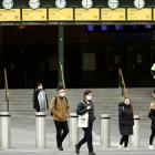 Mask-wearing people in front of Flinders Street Station in Melbourne earlier today. Photo: Getty