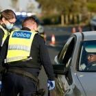 Police carry out random mask checks on motorists at St Kilda's Marine Parade in Melbourne at the...
