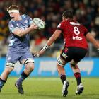 Hurricanes lock James Blackwell looks to sidestep Whetu Douglas of the Crusaders during a...