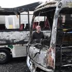 Good Company Tours owner and operator Richard Trainor looks at the damage done after two of his...