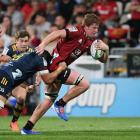 Cullen Grace of the Crusaders charges forward during the round four Super Rugby match between the...