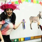 """Brazilian Rafaella Melo shows how to play """"put the tail on the donkey"""" at the Brazilian party..."""