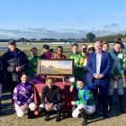 Jockeys and officials joined commentator Dave McDonald for a presentation on his last day of...