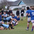 Southland Boys' first five-eighth Kaea Nikora-Balloch is tackled by King's openside flanker Jay...