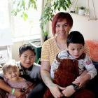 Danni Rasmussen holds Andre, 4, with Avie Avana, 2, and Alize, 11. They hope to soon embark on a...