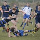 Action from today's game between Dunedin and Kaikorai at Kettle Park. Photo: Gerard O'Brien