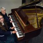 Otago Girls' High School pupil Anika Perenara (17) plays a baby grand piano given to the school...
