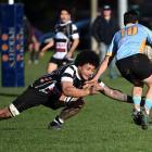 Southern lock Eli Tonga tries to stop University first five-eighth Kody Edwards at Bathgate Park...