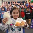 Chloe Prasad (7) and other Pine Hill School pupils are big fans of the Government's free lunches....