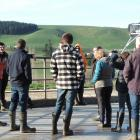 Lyndon Strang (left, in orange jacket) tells Otago Regional Council staff how the dairy farm's...