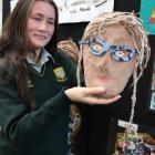 Bayfield High School art pupil Natalie Copson (14) prepares to put an artwork by Tainui School...