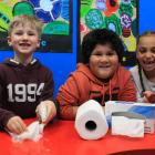 Tainui School pupils (from left) Jonas Machek (7), Harry Gill (7) and Annika Rudd (6) continue to...