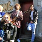 Saurian band members (from left) Silas Wynlaegan (bass guitar), Karl Brinsdon (vocals/guitar),...
