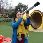Greater Green Island Community Network worker Larna McCarthy looks through a telescope in the...