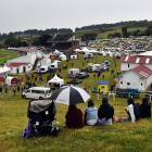Punters enjoy the New Year's Day race day at the Waikouaiti Racing Club course at the beginning...